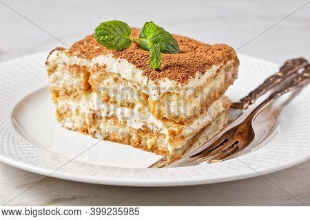 Classic Italian Dessert Tiramisu Of Ladyfingers Or Savoiardi Soaked In Espresso And Mascarpone Mixed