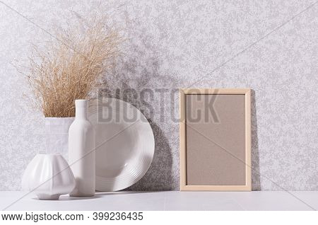 Scandinavian Minimalist Interior With Ceramic Crockery, Dried Grass Bouquet, Blank Photo Frame For P