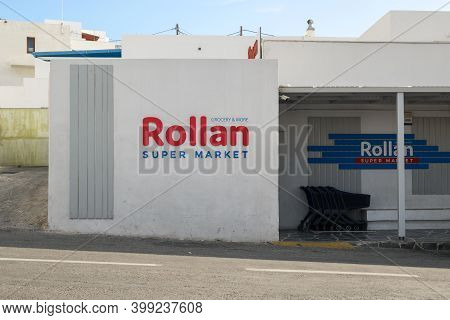 Ios, Greece - September 20, 2020: Supermarket Rollan At Main Square Of Chora, Ios Island. Cyclades,