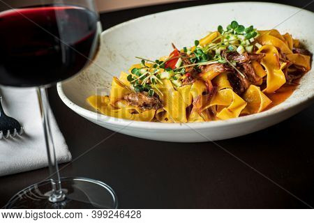 Tagliatelle with oxtail and herbs