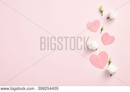 Happy Valentines Day Concept. Paper Hearts And Rose Flowers On Pink Background. Flat Lay, Top View,