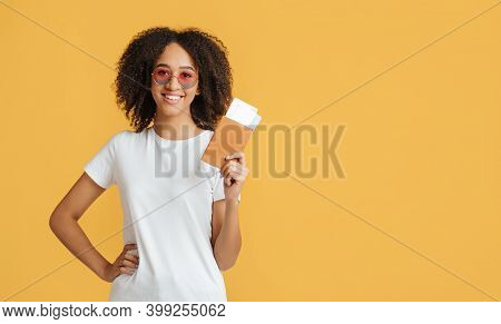 Low-cost, Air Travel And Tourism. Happy Young African American Lady With Curly Hair In White T-shirt