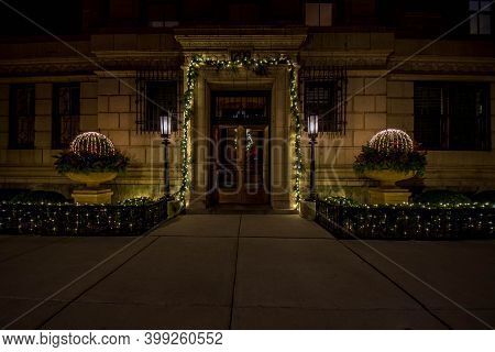 Chicago, Il December 9, 2020, Front Entrance To Apartment Condo Building Nicely Decorated Adorned Wi