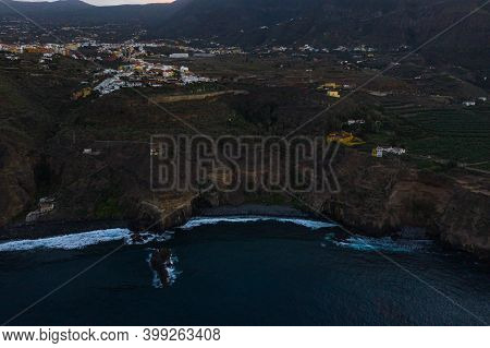 Aerial View Of Playa Castro Flying In Reverse During The Evening, Tenerife