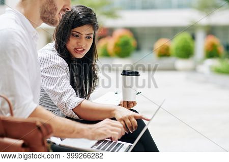 Emotional Young Indian Businesswoman Pointing At Laptop Screen When Trying To Prove Her Point