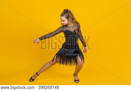 Life In Motion. Child In Dance Pose. Professional Slowfox And Quickstep. Waltz And Tango. Dancewear