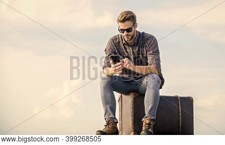 Luggage Concept. Handsome Traveler. Guy Outdoors With Vintage Suitcase. Calling Taxi. Travel Agency.