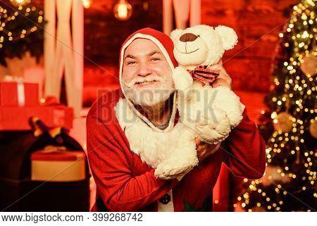 Bearded Grandfather Senior Man Celebrate Christmas. Kind Grandpa With Teddy Bear. Christmas Decorati