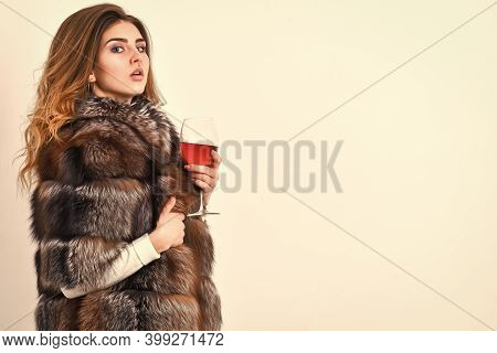 Wine Culture Concept. Reasons Drink Red Wine In Wintertime. Woman Drink Wine. Girl Fashion Makeup We