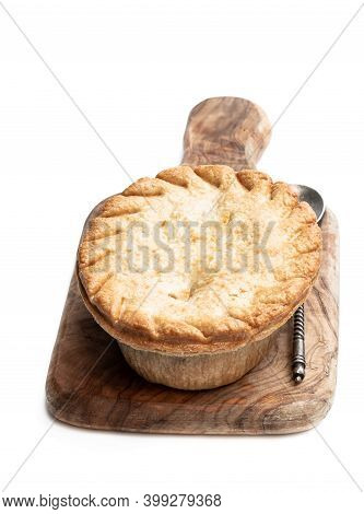 Homemade  Flaky Pasty With Steak And Ale Gravy Filling Isolated On White