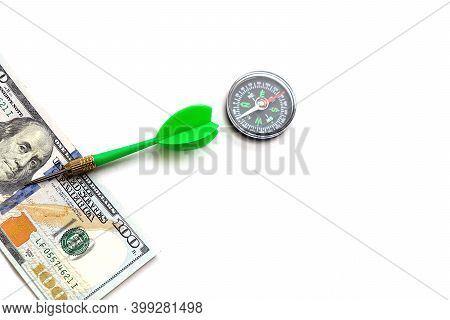 100 American Dollars On A White Background And Compass, To Make Correct And Accurate Investment,