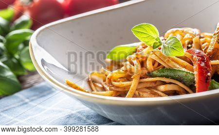 Cooked Linguini Pasta With Vegetables And Parmesan Cheese Served On A Plate.