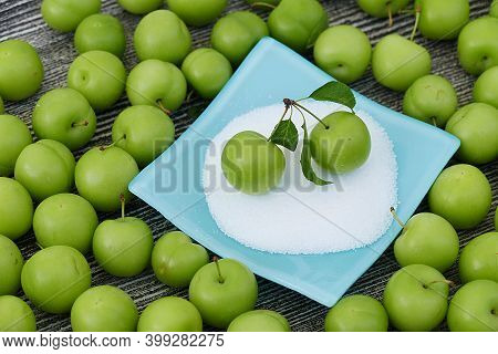 Green Fresh Sour Plums And Salt In The Dish, Sour Plums With Salt,