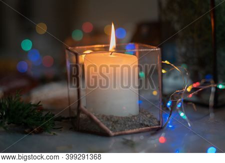 A Burning Candle In A Glass Holder In An Atmospheric Cozy Atmosphere At Home At Night By The Light O