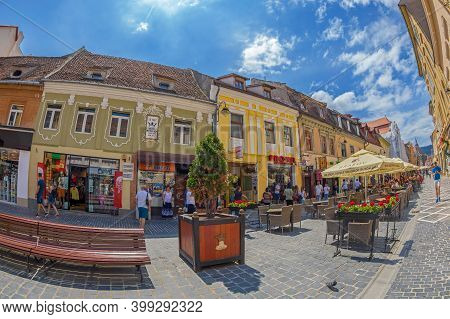 Brasov, Transylvania, Romania - July 12, 2020: Small Shops And Terraces Located On The Picturesque S