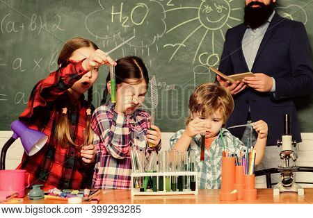 School Club Education. Topic Of Our Club. Teacher And Pupils Test Tubes In Classroom. Chemistry Them