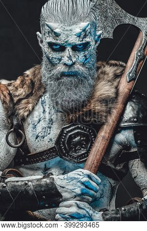 Armed With Two Handed Axe Dead Northern Chief In Dark Armour With Fur And With Pale Skin In Dark Bac