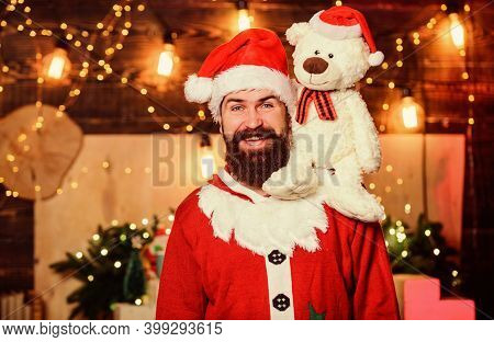 Kindness And Generosity. Charity Concept. Man Bearded Santa Claus Play With Soft Toy Teddy Bear. Chr