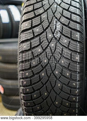 Closeup View Of A Studded Winter Tire Tread