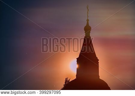 Orthodox Church In The Light Of Evening Haze. Misty Sunset And Church In The Sun. Fog Over The Ortho