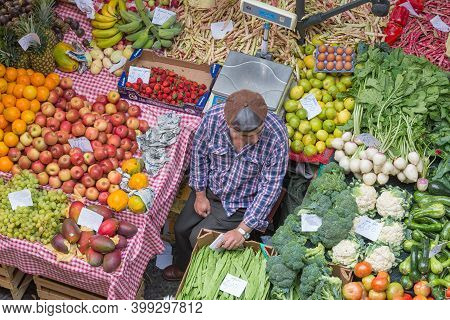 Funchal At Madeira, Portugal - August 01, 2014: Vendor With Cab Selling Fresh Vegetables At Famous M