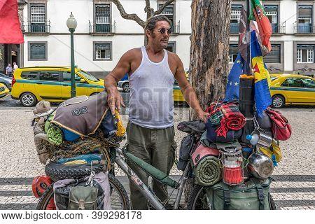 Funchal At Madeira, Portugal - August 01, 2014: Adventurer Who Traveled 67000 Kilometer Through Eurr