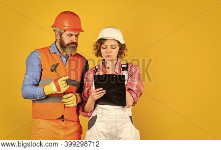 Family Counting Finances For Renovation. Renovation Concept. Couple Planning Changes Renovation Apar