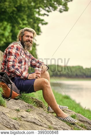 Man With Cup Outdoors. Man Outdoors With Cup Of Coffee. Drinking Hot Coffee. Enjoying Nature At Rive