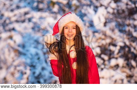 Child Happy Girl Outdoors Snowy Nature. Merry Christmas. Happy Childhood Concept. Happiness And Joy.