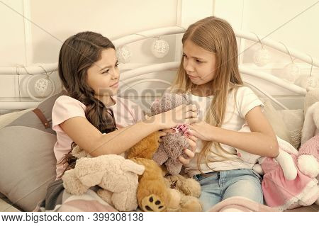 Generosity And Greediness. Teach Sister Sharing Toys. Greedy Sisters. Kids Play Toys In Bed. Little