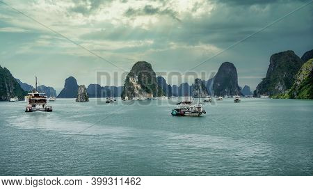 Ha Long Bay, Vietnam - December 2015: Tourist Boat Sailing In Ha Long Bay At The Gulf Of Tonkin Of T