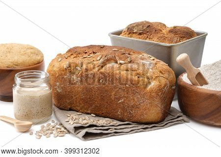 Homemade Sourdough Bread, Natural Leaven For Bread In A Glass Jar, Wooden Bowl Of Dough And Bowl Of