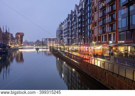 Gdansk, Poland - December 12, 2020: Modern Tenements And Riverside Promenade Along Motlawa River In