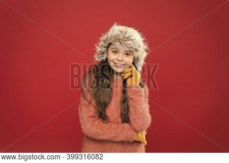 Kid Girl Smile Red Background. Soft Furry Accessory. Winter Season. Small Fashionista Concept. Feeli