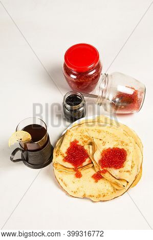 Traditional Russian Pancakes With Red Caviar. Close Up Pancakes With Red Caviar, Cans Of Red Salmon