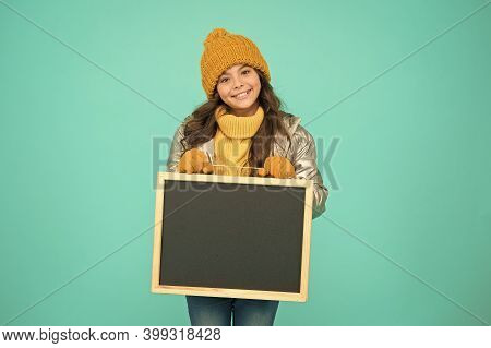 Happy Hours. Promotion Concept. Smiling Girl Wear Winter Outfit Show Blank Chalkboard Copy Space. Fr