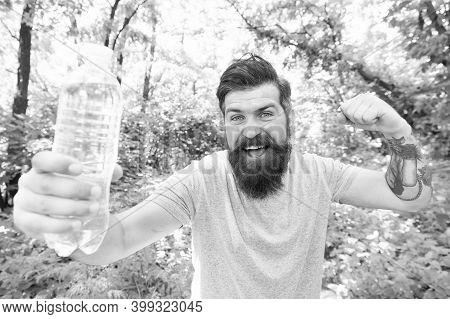 No Sweat. Bearded Man Full Of Energy. Brunette Bearded Man With Water Bottle In Forest. Brutal Brune
