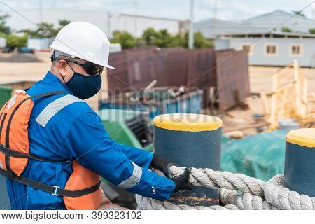Deck Officer Performing Work On The Ship's Deck, Wearing Ppe