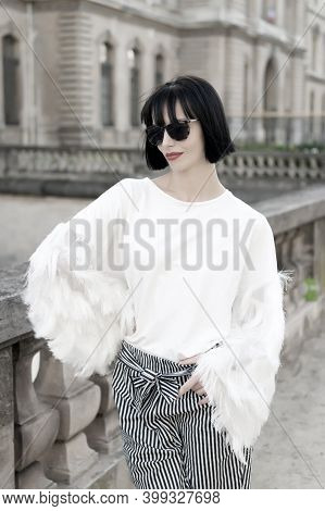 Model In Fashionable Clothes On Street Of Paris, France. Woman With Red Lips And Brunette Hair. Fash