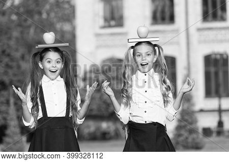 Imagination Takes You Everywhere. Happy Kids Hold Books And Apples On Heads. Childhood Imagination.