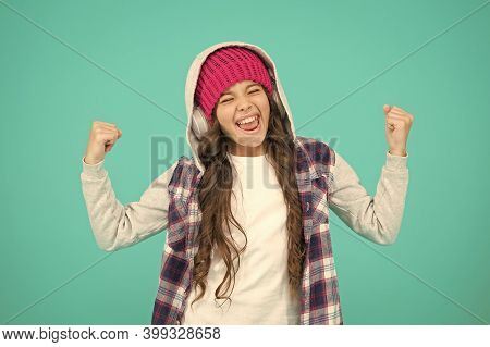 Feeling Success. Happy Hipster Girl Turquoise Background. Smiling Teenager Listen Music In Earphones