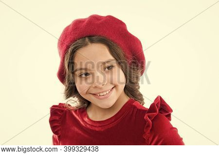 Fashion Portrait Of Fashionable Girl Wearing Trendy Hat. Beautiful Happy Smiling Girl. Kid From Pari