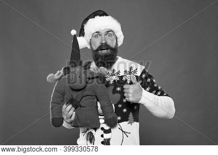 Santas Favorite Deer. Happy Hipster Give Like With Reindeer Toy. Bearded Man Show Thumbs Up Like Han