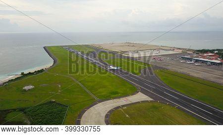 Bali, Indonesia, December 4, 2020. Aerial View Passengers Airplanes At The Airport Runway. Garuda In
