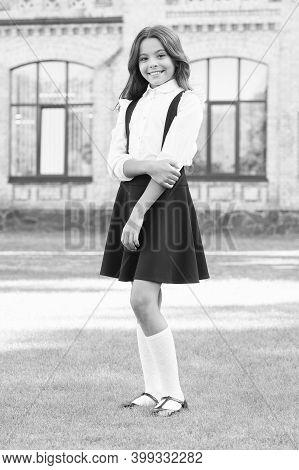 Pretty Little Girl Wear Classy Uniform. Back To School. Modern Education. Kid Pupil At Schoolyard. S