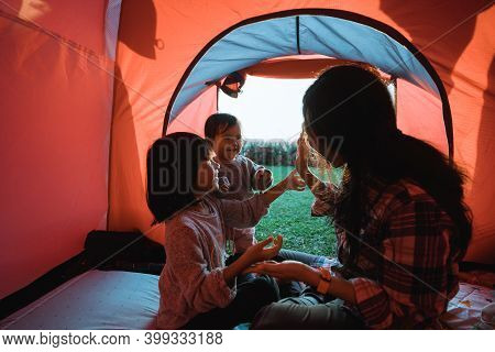 Portrait Of The Campground Family Playing Together