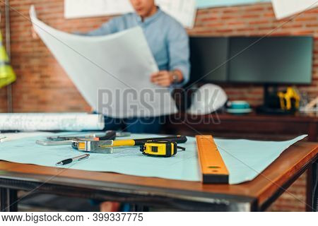 Measure Tape, Calculate,  Safety Helmet, Book On House Blue Print. Engineering, Plaining, Drafting