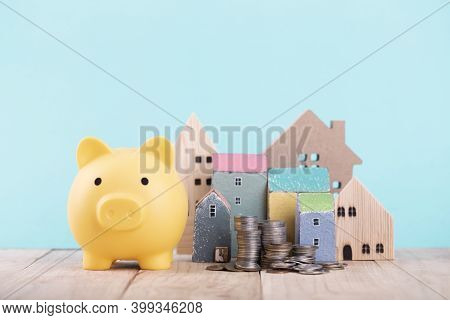 Piggy Bank For Save For Home ,planning For The Future Of Rent For An Apartment Or Home Concept .the