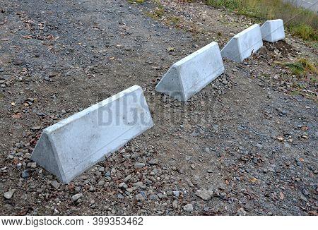 Horizontal Road Marking Lanes. Highway Concrete Barriers On The Road. Vehicle Collision Lane Separat