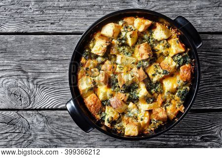 Italian Spinach Strata Or Breakfast Casserole Of Cubed Bread Baked With Chopped Spinach And Shredded